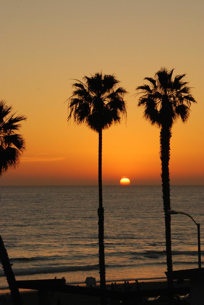 Picture of the sunset at the entrance of the Oceanside Pier.