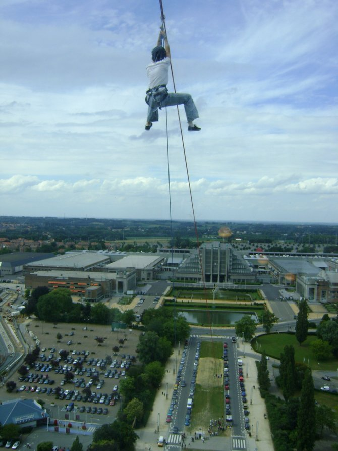 Timing is everything- this shot was taken from the top of the Atomium, built for the 1958 Brussels World Fair. Catch a glimpse of this zipliner's view!