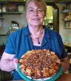 Judy, the pie lady, holding an apple-caramel-pecan pie, Apple Alley Bakery & Coffee, Julian, CA