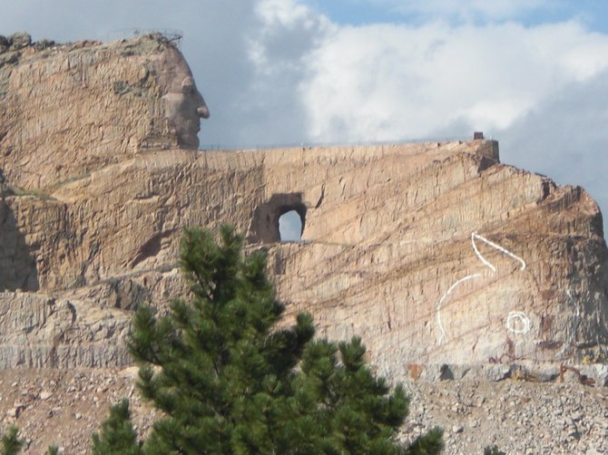 This is the Crazy Horse monument which is still under construction and is located in the Black Hills of South Dakota.