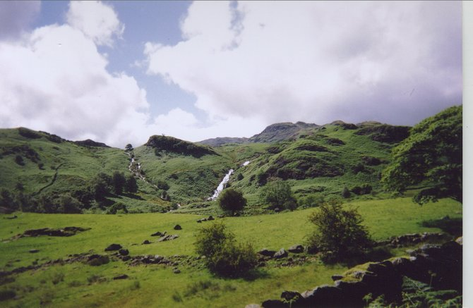 A waterfall appears on one of the many Lake District hikes in England