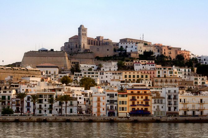 The island of Ibiza off the coast of Spain is the party capital of the world.  The colorful buildings in Ibiza City fit the party atmosphere.