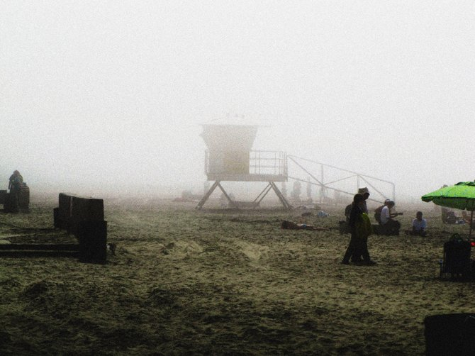 We went to Mission Beach to try and get some photos of surfers and the rollercoaster, but it was pretty foggy today at the beach. When I looked at this photo, it reminded me of an old photo, so I added the noise for texture. Except for the green in the beach umbrella, it gives a sort of black and white effect. The only thing I have added or edited was the noise addition. Everything else is just as it was taken.