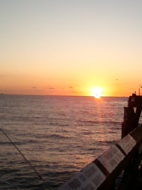 Watching the sun go down on the pier, (Imperial Beach).  Be careful not to blink because you just might miss it!