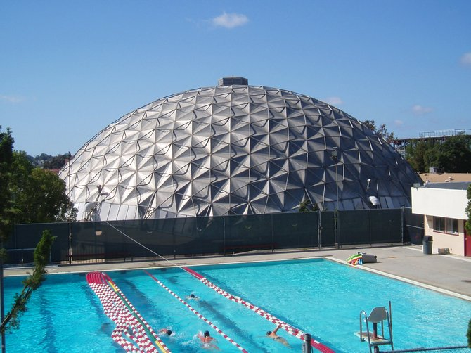 A view of the geodesic dome gymnasium next to the swimming pool at Palomar College. It  looks like a scene from a mid-century spa hotel that could have existed back in the 50's in Palm Springs or Desert Hot Springs.  Either that, or a giant space ship landed on campus. Does anyone remember the Sands Hotel that used to be by the 163 right near Clairemont Mesa Blvd.? It wasn't a geodesic style dome, but it was a big cement dome that was from the same era. Architectural domes are really interesting and we don't have enought of them in San Diego.