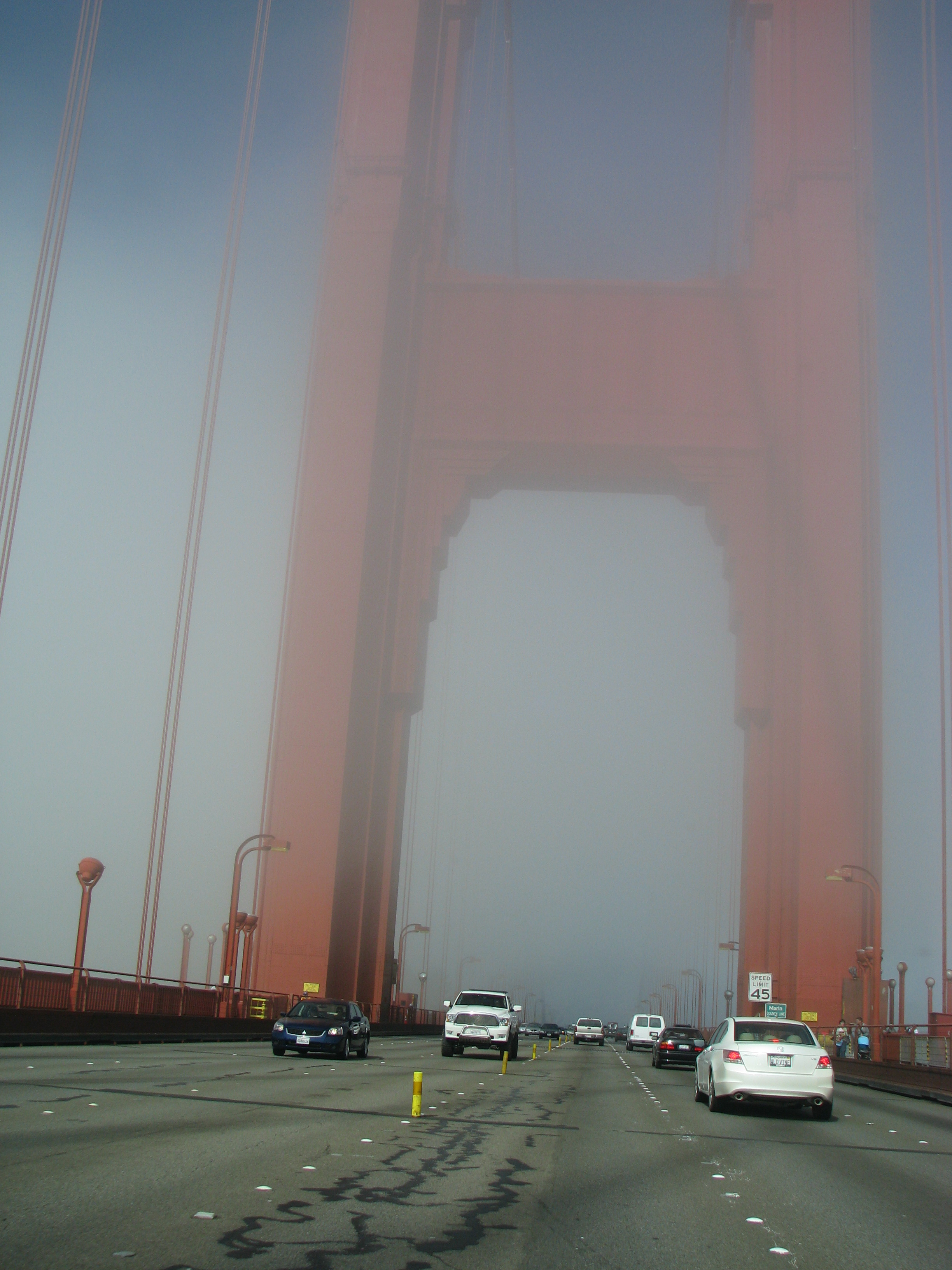 The Golden Gate Bridge on a foggy day as we drove across.