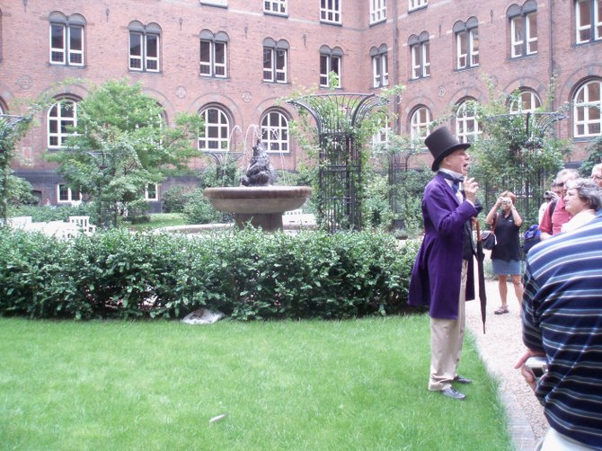 Richard Karpen, as Hans Christian Andersen, leads a walking tour in Copenhagen, Denmark.