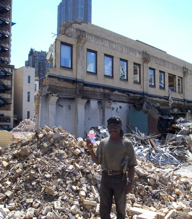Chicago Gentrification -- My grandson's Flat Stanley traveled from San Diego to Chicago & met this worker on a River North section gentrification project. River North and West sprouted & then exploded in the past half-decade thanks to the conversion of storage & manufacturing facilities into hard loft residences & the construction of new single-family homes, condos & high-rises.  All this was amidst very hip galleries, restaurants, shopping & easy access to highways & the lakefront. An estimated 25,000 new residents, occupying some 10,000 new condominiums, have moved into the neighborhood since 2000.  Note the curtains & shade still on one window even though the room behind is totally demolished.