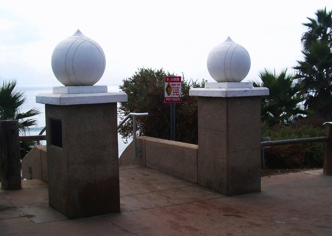 "This is a photo of the onion domed ""sentries""  which are modeled after the golden onion domes atop the Self Realization Fellowship Temple, marking the way toward the staircase that leads down to Swami's beach."