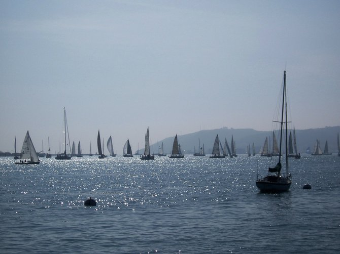 Sailboats on the bay off Shelter Island on a slightly foggy day.