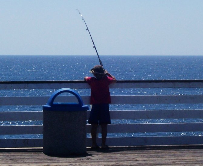 This was taken on my favorite place, Crystal Pier. There are a lot of fisherman here all of the time but this one I thought was the best and sweetest person trying to make a catch  the pier that day in September.