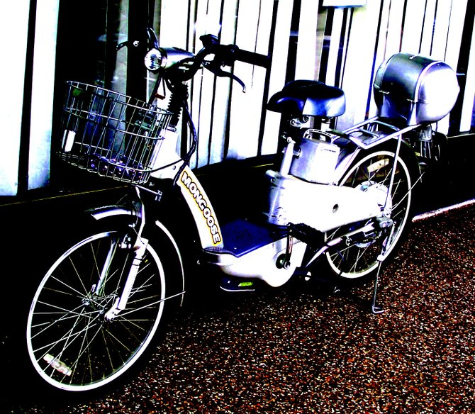 Taken in front of the downtown library. A vintage-style scooter parked outside caught the attention of alot of passersby.