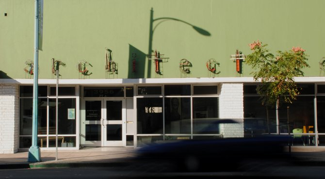Architecture firm in North Park on 30th Street. Great contrast of artistic recycled metal against green wall.