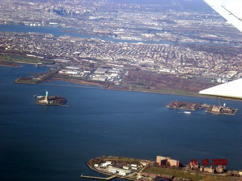 View of the Statue of Liberty and Ellis Island in New York Harbor from the air. More than 12 million immigrants passed through the Ellis Island facility between 1892 and 1954.