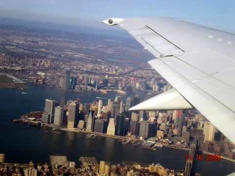 New York City - view from airplane of the Brooklyn Bridge over the East River, Lower Manhattan, the Hudson River and Jersey City.