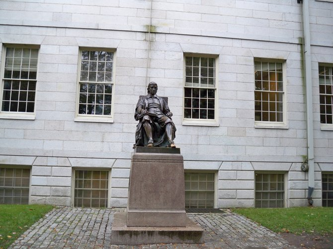 The John Harvard Statue at Harvard University in Cambridge, MA.