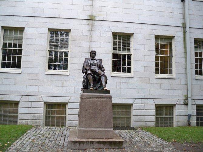 The John Harvard Statue at Harvard University in Cambridge, MA.