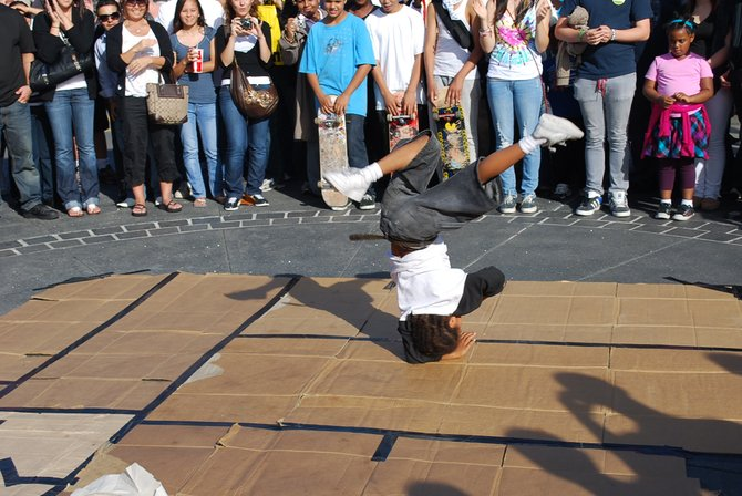 I was visiting my boyfriend and we went to the wharf and saw this 6 year old dancer -- was awesome!