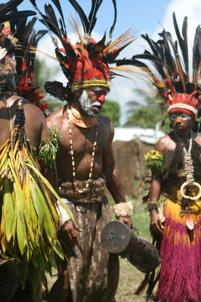 Members of a Papua New Guinea Highlands tribe prepare for a traditional dance ceremony.