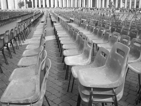 "This is right outside the Vatican in Italy. All these chairs were put out so that people could sit and see the Pope. I title the photo, ""Waiting for Godot"""