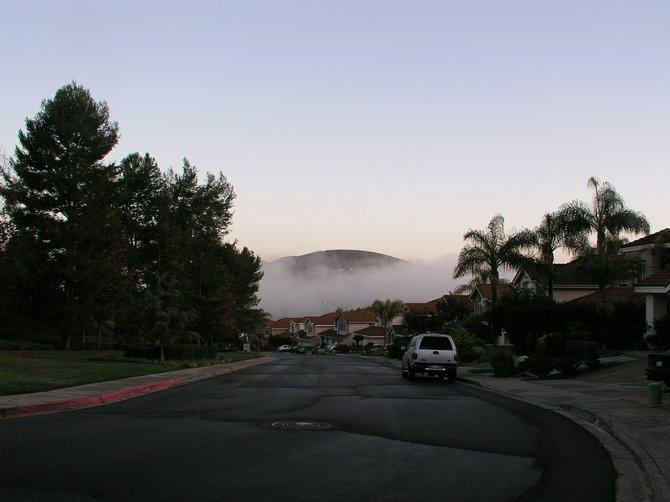 Fog traveling Rancho Penasquitos canyon after rain.  2009.