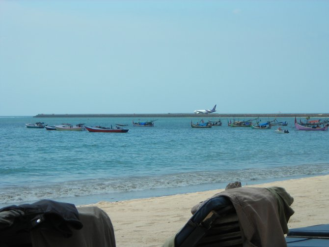 View of fishing boats and Denspasar Airport runway from restaurant on Jimbaran Bay (Bali)