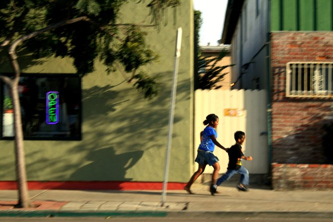 I spotted these two kids by Rocky's Surf Shop, they were racing each other down the street. The girl was mad that the little boy kept winning, so she caught up to him and grabbed his shirt. Poor guy :(