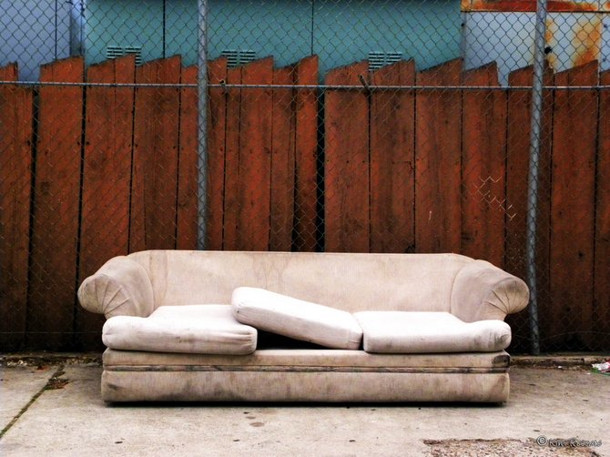 A couch left in an alley in City Heights