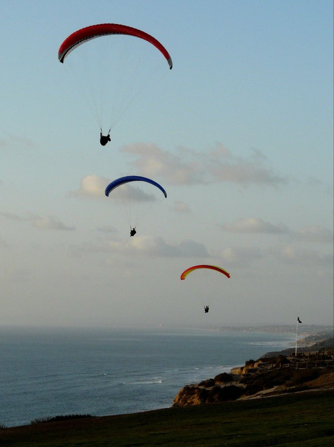 A trio of paragliders enjoy the breeze at the Torrey Pines gliderport.
