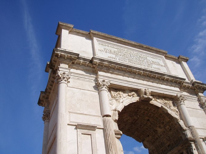 The Arch of Titus on a clear day in Rome, Italy.