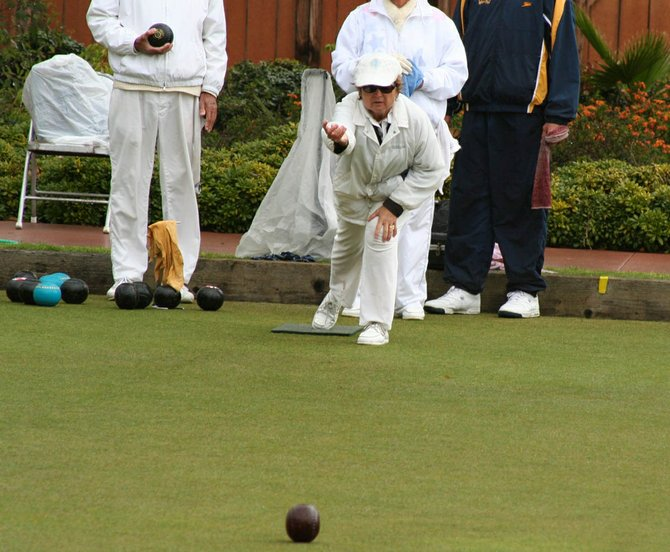The rain couldn't stop this lawn bowling game from proceeding.