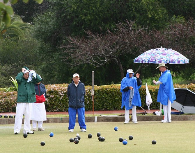 The rain couldn't stop these folks from lawn bowling.
