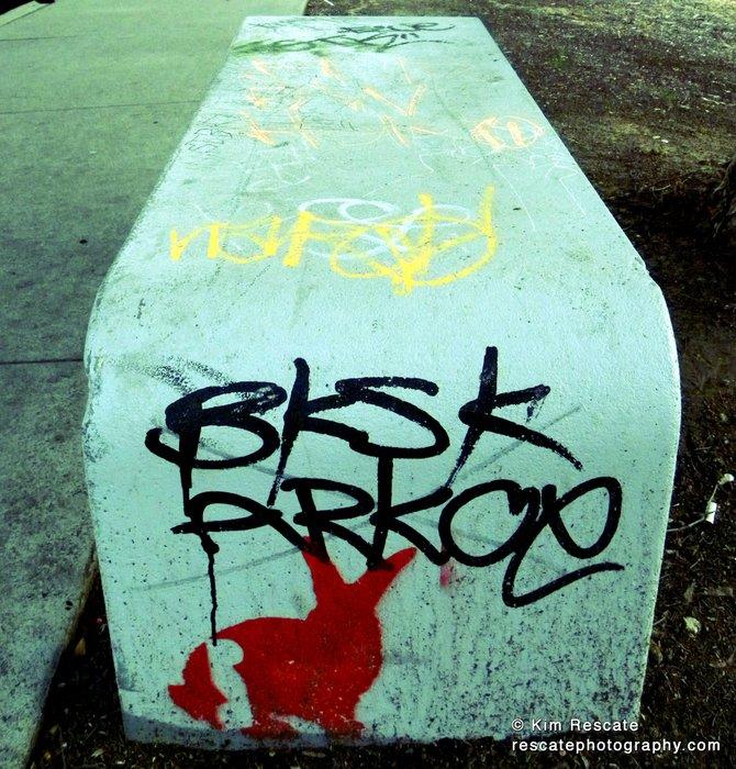 Graffiti on a bench.