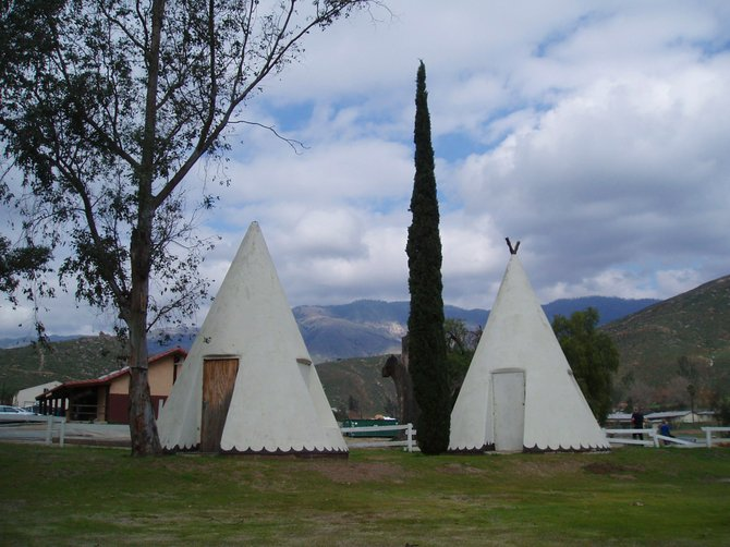 These two white painted concrete teepees stand on the property of what used to be the Rincon Chapel Assembly of God church. I'm not sure what the teepees were used for, although both of them have a door, or opening, on one side of them. They might enclose electrical or plumbing components that were used by the church. Who knows? The church building is dilapidated and looks like it was abandoned many years ago. The teepees and the abandoned church building are right across the way from the sparkling new Catholic chapel, St. Bartholomew's, in Valley Center.