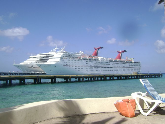 A view from the shore of Cozumel of cruise ships Inspiration I and Fascination.