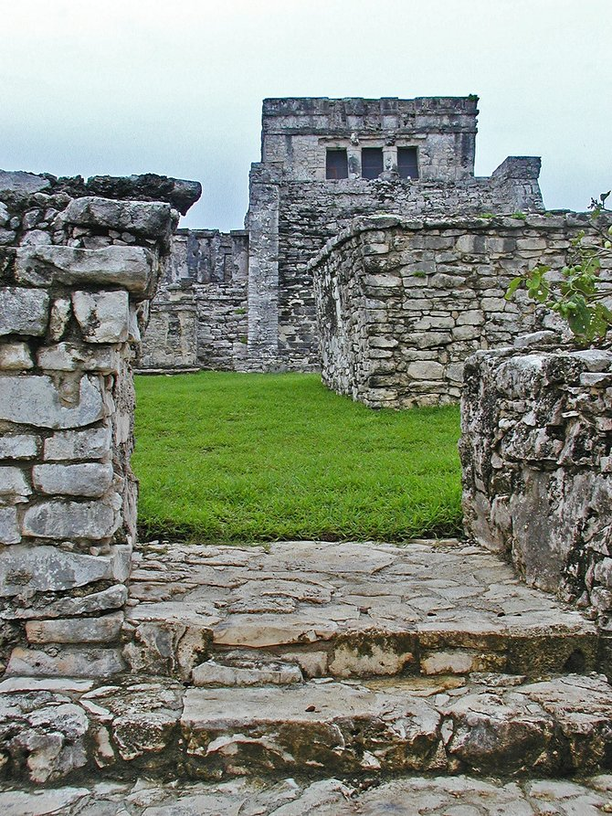 Approaching the steps of El Castillo in the Mayan city of Tulum. Iguanas now guard the ruins of this ancient walled fortress on the beach.