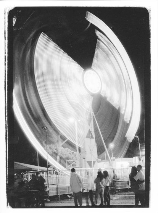 A midnight carnival in Imperial Beach. Shot with a Canon AE-1 with Ilford 400.