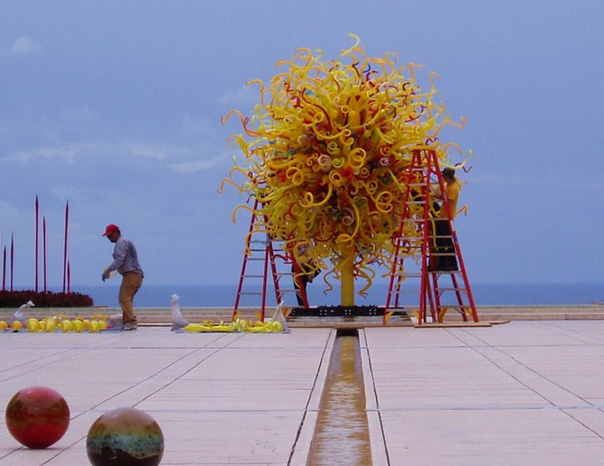 "Workers installing Dale Chihuly's ""Sun"" at the Salk Institute."