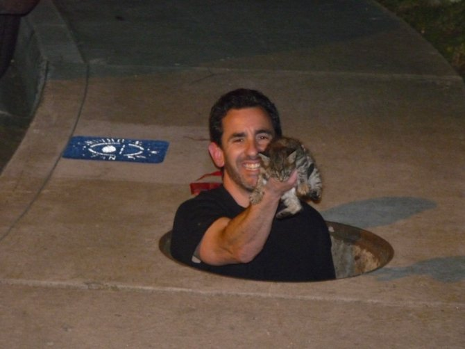 This is a photo showing my best friend Dan Galant as he finally saved a kitten who had somehow gotten into a storm drain. Dan was down there for almost two hours with different food bribes to get the kitty to come over.We were able to get her a new home with a friend.