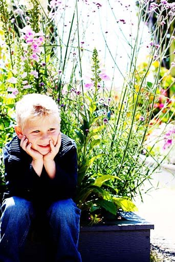 "This is a very active boy waiting SO patiently to go play in ""Santa's Village"" at the Carlsbad Flower Fields."