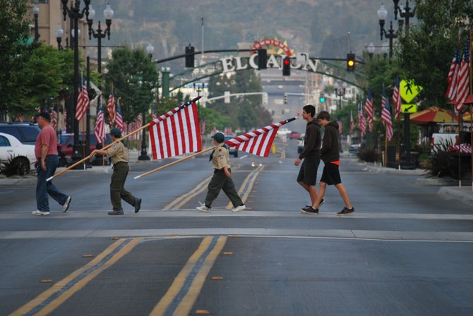 Great example of Pride by Boyscout troop 362 out of Rancho San Diego finds you in time to print. Every year they go out and place the flags in the early hours along Main St. in El Cajon. To help us celebrate our Freedom. All the flags are Provided by the El Cajon Elks.