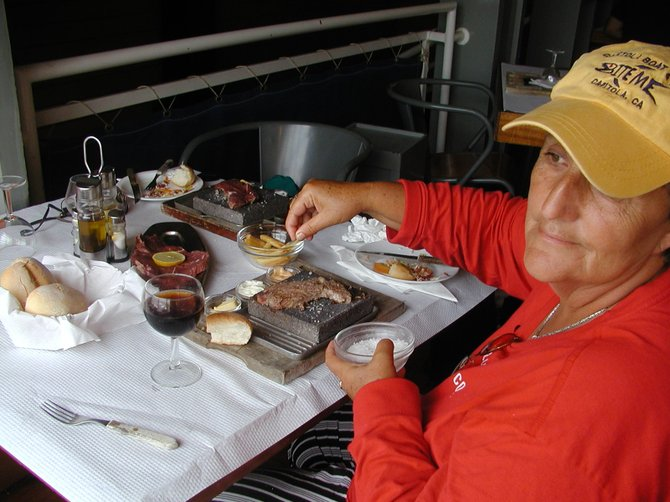 Don't try this at home! Cook it yourself steak, right at your table, on searing hot lava rock dishes: A restaurant on the island of Faial, Azores