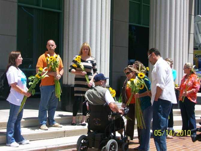 Chelsea's Light Facebook group gather at downtown Courthouse steps and hold sunflowers and lilies in memory of Chelsea King & Amber Dubois on John Gardner's sentencing day.
