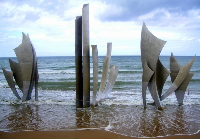A simple picture of the Les Braves sculpture on Ohama Beach in Normandy, France. It was made in 2004 to honor the lives of those who had fallen on that beach during the D-Day invasion. Very pretty, very serene!