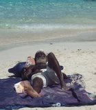 A local West Indian chills out on a hot day on Coki Beach, St. Thomas ...