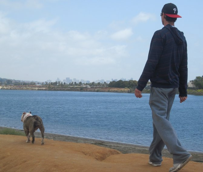 A man and his best friend on fiesta island, Mission Bay.