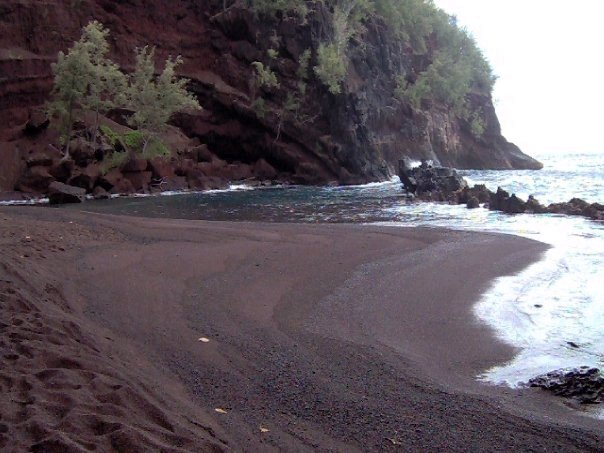 A picture of Red Sand Beach in Maui.  Water was crystal clear blue and the sand was brick red.