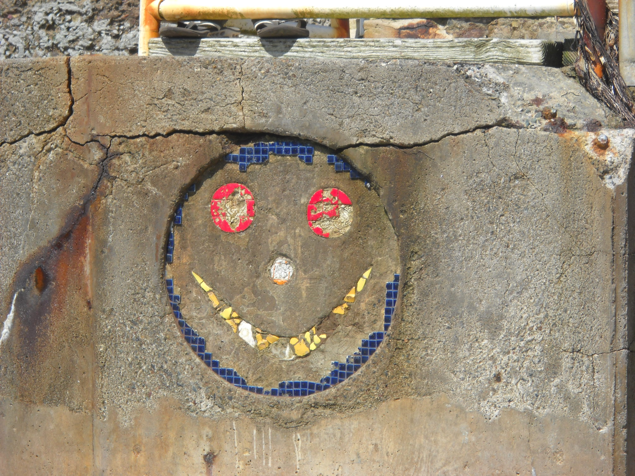Happy Face set in stone. Bermuda Street beach.