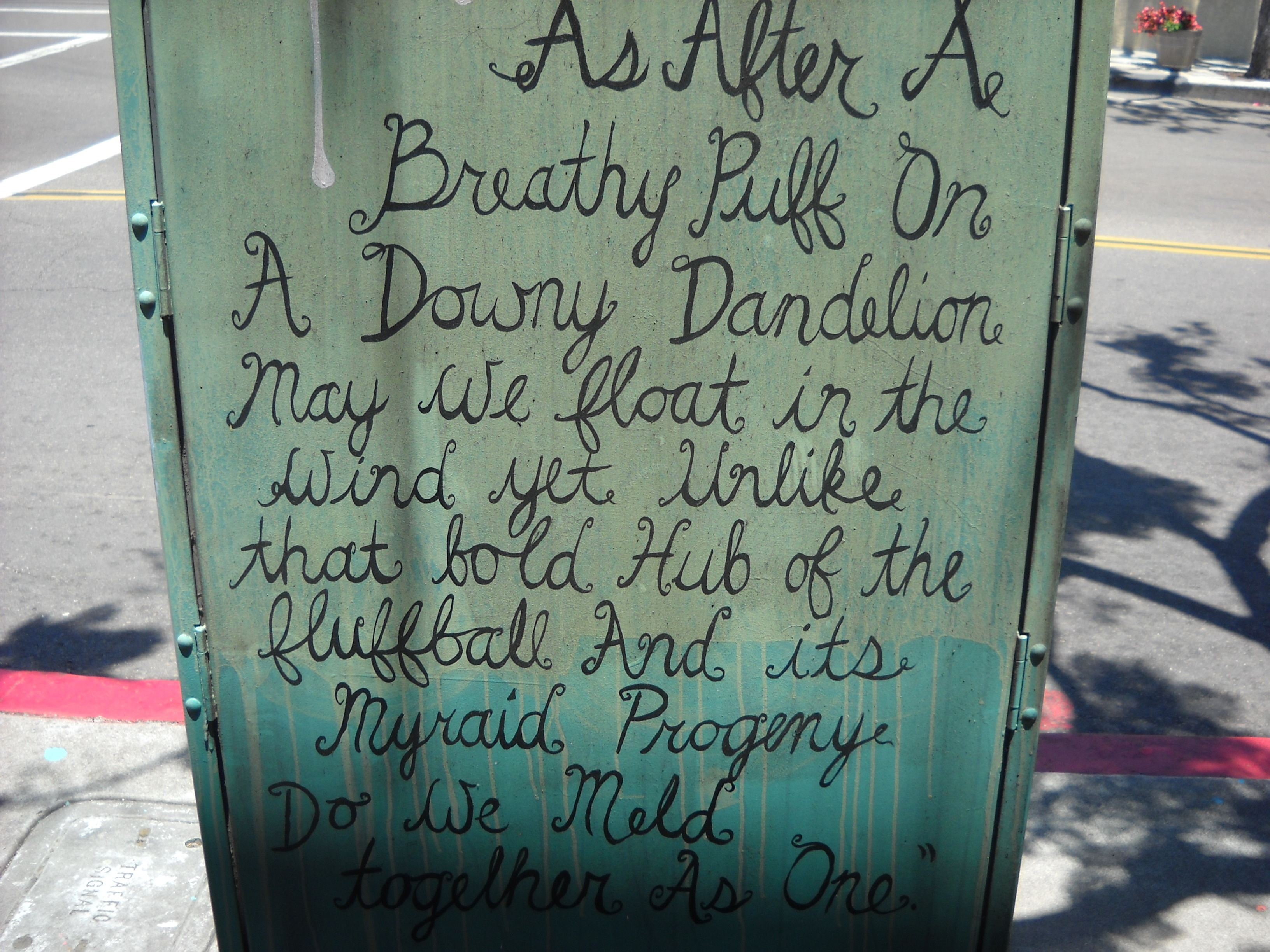 Written prose on a utility box near Canon Street and Rosecrans in Point Loma.
