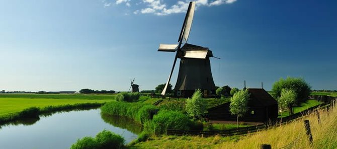 A picture of Holland. Holland strictly refers only to the country's two southern provinces, whereas Netherlands is the official name of the country and appears on the country's currency and stamps.